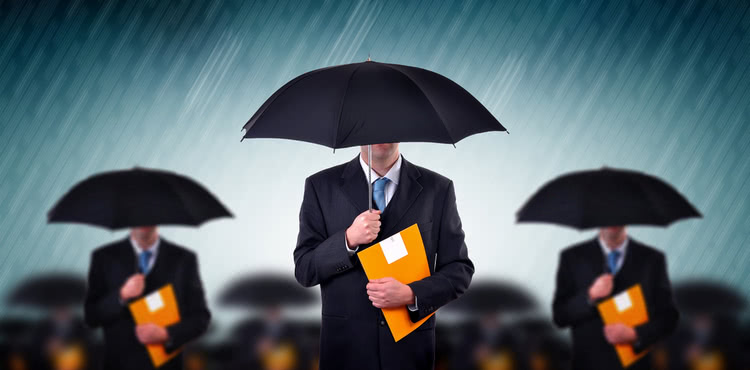 Businessmen carrying umbrellas during a storm