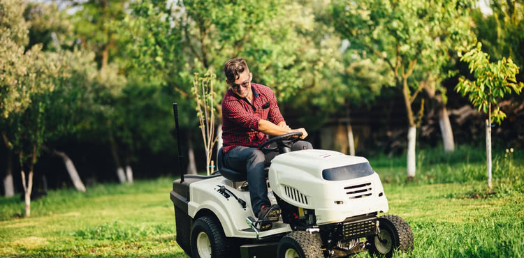 A man on a riding lawnmower