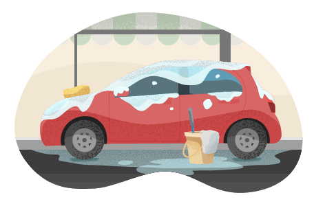Red car with soap suds and bucket at car wash.