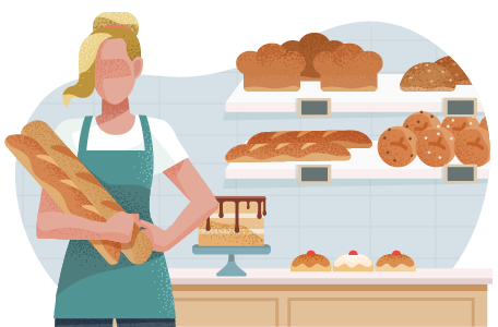 Baker holding baguettes in front of a display of baked goods.