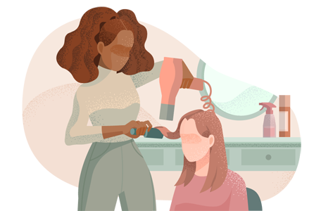 Hairstylist blowdrying a client's hair.