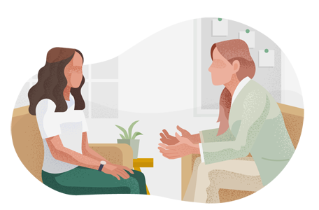 Occupational therapist speaking with female client.
